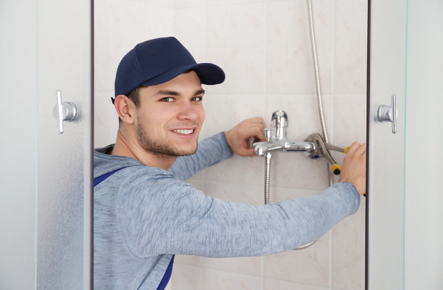 sydney plumber repairing a leaking shower in the bathroom